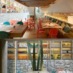 A vibrant, colourful restaurant with a terrace on the street, cactus, wood and stones inside.